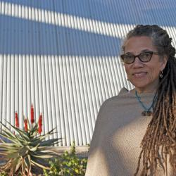 Nikky Finney stands in front of desert plants outside the Poetry Center, photo by Patri Hadad